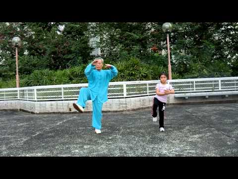 Tai Chi Master And A Little Girl